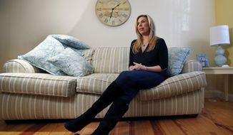 2013 Boston Marathon bombing survivor Heather Abbott speaks during an interview at her home in Newport, R.I., Friday, Dec. 12, 2014. For Abbott, who lost her left leg, One Fund Boston helped cover the costly prosthetics that allowed her to reclaim some degree of normalcy. Twenty months and $80 million later, the charity set up to help victims of the bombings is closing down. (AP Photo/Elise Amendola)