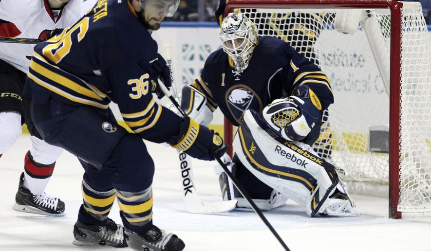 Buffalo Sabres' Patrick Kaleta (36) and goaltender Jhonas Enroth (1) defend as Ottawa Senators' Alex Chaisson looks on during the second period of an NHL hockey game Monday, Dec. 15, 2014, in Buffalo, N.Y. (AP Photo/Gary Wiepert)