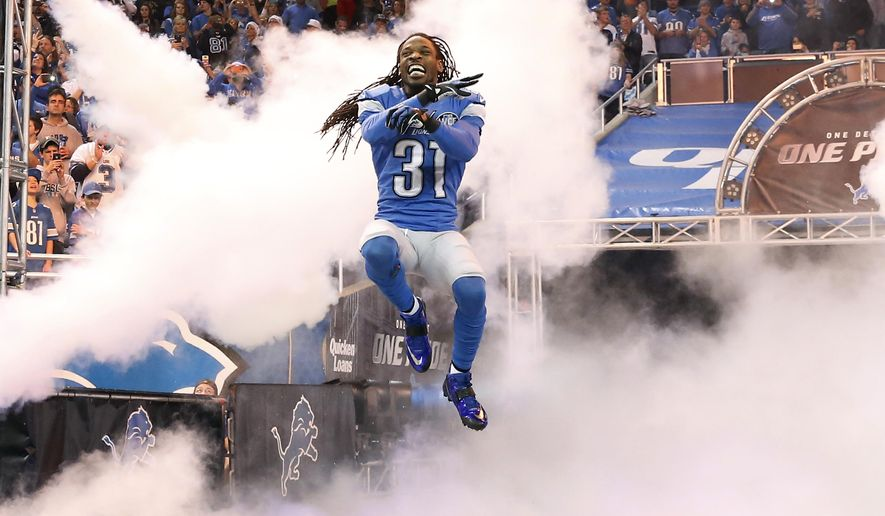 Detroit Lions cornerback Rashean Mathis jumps during his introduction before the first half of an NFL football game against the Minnesota Vikings at Ford Field in Detroit, Sunday, Dec. 14, 2014. (AP Photo/Rick Osentoski)