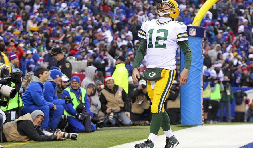 Green Bay Packers quarterback Aaron Rodgers (12) reacts after Jordy Nelson (87) drops a pass during the second half of an NFL football game against the Buffalo Bills, Sunday, Dec. 14, 2014, in Orchard Park, N.Y. (AP Photo/Bill Wippert)