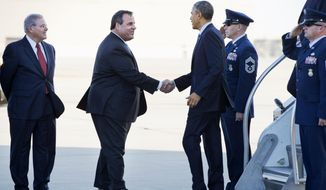 New Jersey Gov. Chris Christie, accompanied Sen. Robert Menendez, D-N.J., left, greets President Barack Obama upon his arrival on Air Force One, Monday, Dec. 15, 2014, at Joint Base McGuire-Dix-Lakehurst, N.J., where the president was expected to speak to troops. (AP Photo/Jacquelyn Martin)