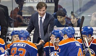 Edmonton Oilers head coach Dallas Eakins talks to his players while playing the New York Rangers during third period NHL preseason hockey action in Edmonton, Alberta, in this Sept. 24, 2013, file photo. Eakins has been fired as coach of the Edmonton Oilers, who have lost 15 of 16 games and are well on the way to missing the playoffs for the ninth consecutive season. (AP Photo/The Canadian Press, Jason Franson, File)