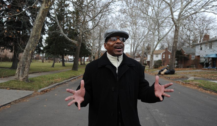 In a Dec. 8, 2014 photo, Emmanuel House Executive director and founder Rev. Timothy Thompson talks about helping our fellow men and women as he walks down a residential street in Detroit, Mich. Emmanuel House provides transitional housing for homeless veterans.  (AP Photo/The Detroit News, Brandy Baker)