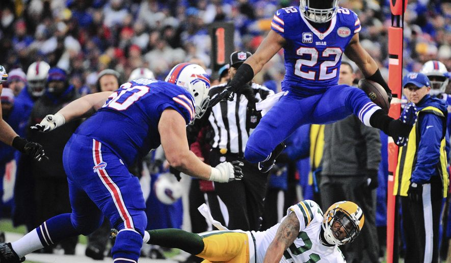 Buffalo Bills' Fred Jackson (22) leaps over Green Bay Packers' Ha Ha Clinton-Dix (21) during the second half of an NFL football game Sunday, Dec. 14, 2014, in Orchard Park, N.Y. (AP Photo/Gary Wiepert)