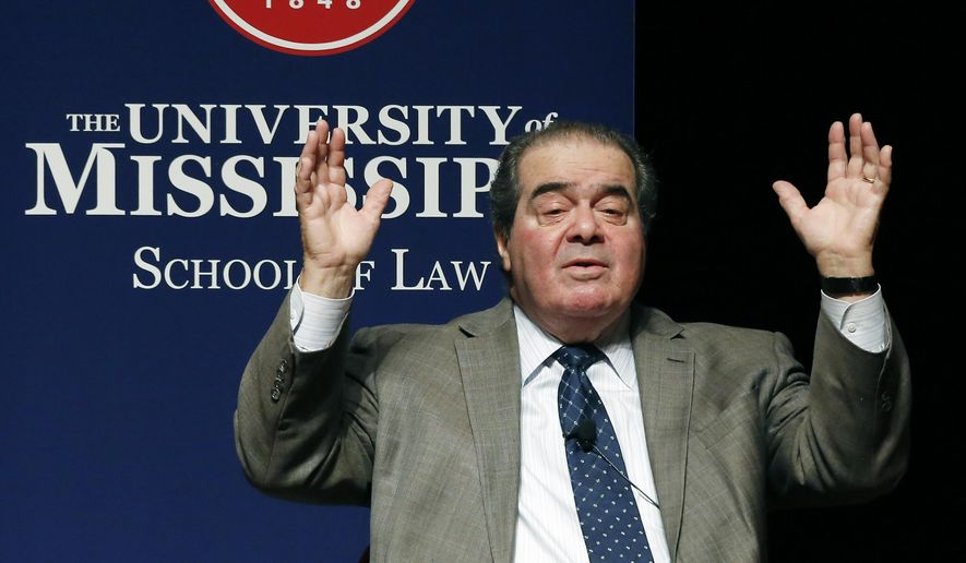 U.S. Supreme Court Justice Antonin Scalia reacts to questions about certain legal decisions at a program with fellow Justice Elena Kagan, Monday, Dec. 15, 2014 at the University of Mississippi in Oxford, Miss. Both justices spoke to an open audience of professionals, professors, students and area residents about their law school and professional experiences as well as some of their court decisions. (AP Photo/Rogelio V. Solis)