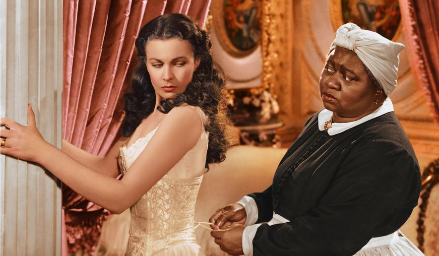 "Vivien Leigh appears in character as Scarlett O'Hara, left, and Hattie McDaniel as Mammy, in the film, ""Gone with the Wind."" (AP Photo/Turner Classic Movies) ** FILE **"