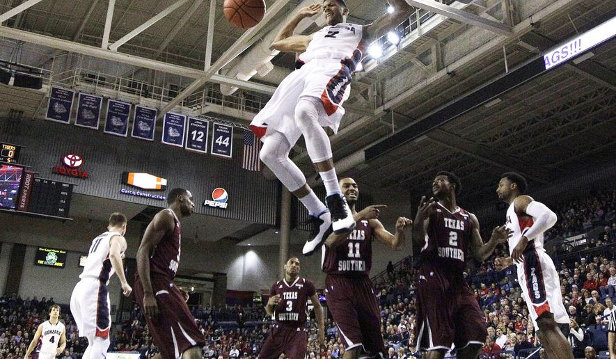 Gonzaga's Angel Nunez (2) dunks against Texas Southern during the first half of an NCAA college basketball game in Spokane, Wash., Monday, Dec. 15, 2014. (AP Photo/Young Kwak)