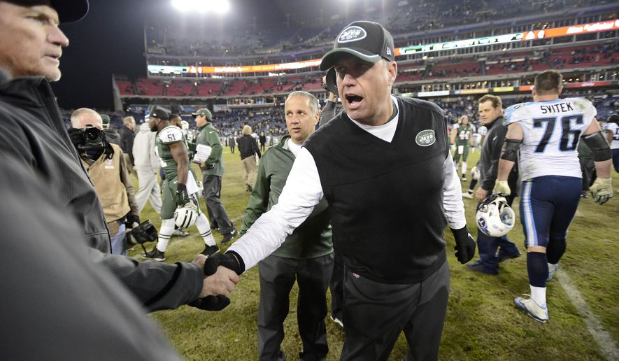 New York Jets head coach Rex Ryan, center, shakes hands with Tennessee Titans head coach Ken Whisenhunt, left, after an NFL football game Sunday, Dec. 14, 2014, in Nashville, Tenn. The Jets won 16-11. (AP Photo/Mark Zaleski)