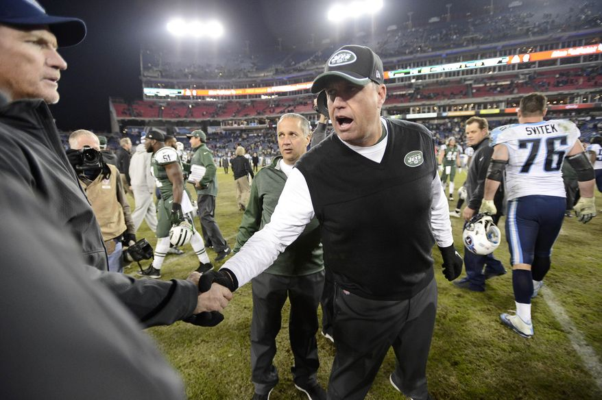 New York Jets head coach Rex Ryan, center, shakes hands with Tennessee Titans head coach Ken Whisenhunt, left, after an NFL football game Sunday, Dec. 14, 2014, in Nashville, Tenn. The Jets won 16-11. (AP Photo/Mark Zaleski)