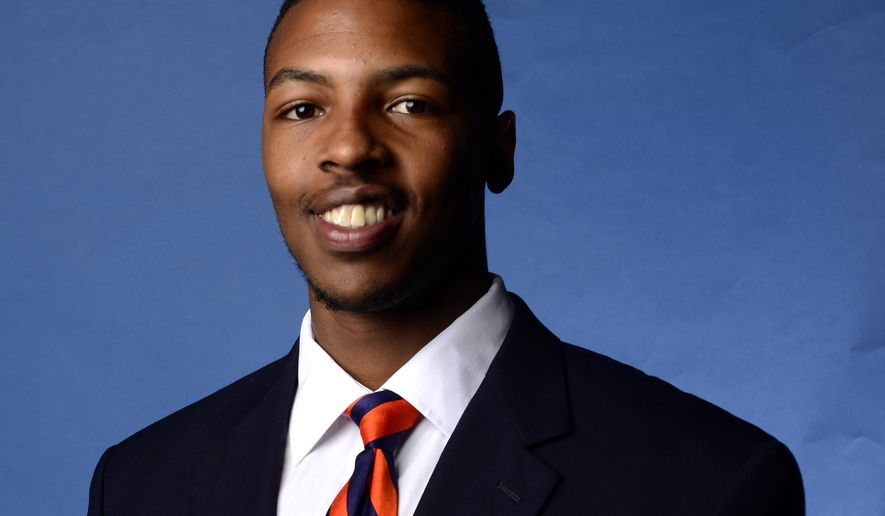 This undated portrait provided by Auburn University shows Auburn football player Jakell Lenard Mitchell. Mitchell was fatally shot early Sunday, Dec. 14, 2014 at an off-campus apartment complex where two former football players and another person were killed in a shooting in 2012, police and reports said. A 22-year-old man has been arrested on a felony warrant charging him with murder. (AP Photo/Auburn University)