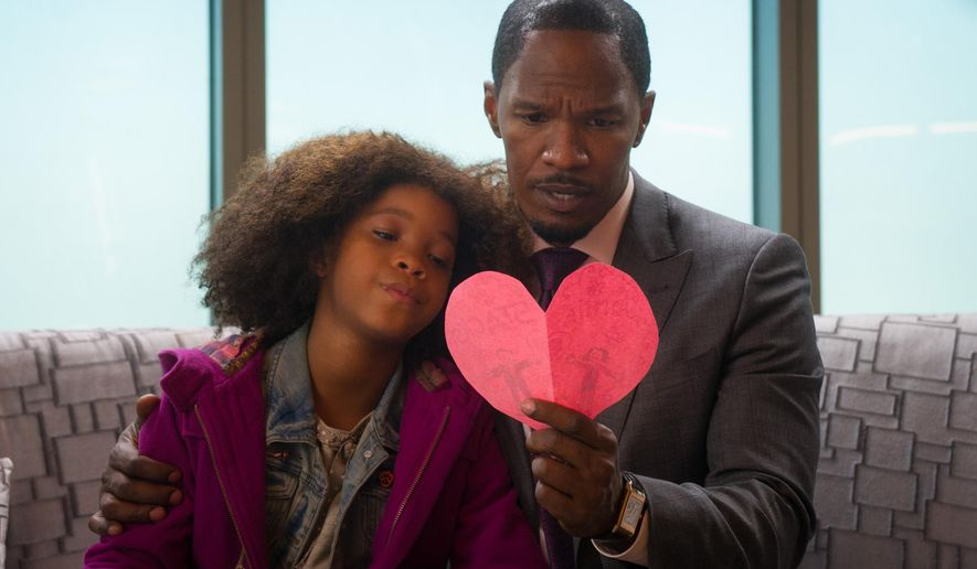 """This photo released by Colombia Pictures - Sony shows Quvenzhane Wallis, left, as Annie, and Jamie Foxx as Will Stacks, looking at a card she made for Stacks in a scene from Columbia Pictures' """"Annie."""" (AP Photo/Columbia Pictures - Sony, Barry Wetcher)"""
