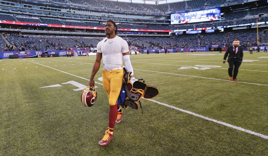 Washington Redskins quarterback Robert Griffin III (10) walks off the field after the New York Giants won 24-13 in an NFL football game, Sunday, Dec. 14, 2014, in East Rutherford, N.J. (AP Photo/Julio Cortez)