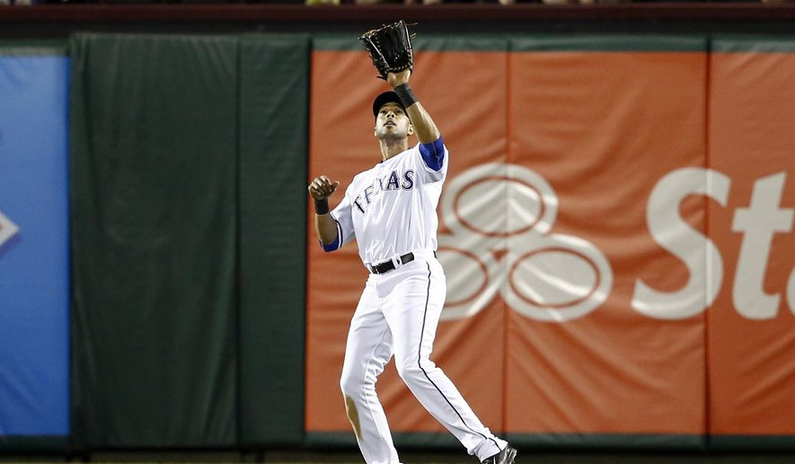 FILE - In this April 2, 2014, file photo, Texas Rangers right fielder Alex Rios catches the fly out hit by Philadelphia Phillies' Jayson Nix during the ninth inning of a baseball game in Arlington, Texas. A person with knowledge of the negotiations says outfielder Rios and the Kansas City Royals have agreed to an $11 million, one-year contract. The person spoke on condition of anonymity Monday, Dec. 15 because the deal was subject to Rios passing a physical. (AP Photo/Jim Cowsert, File)