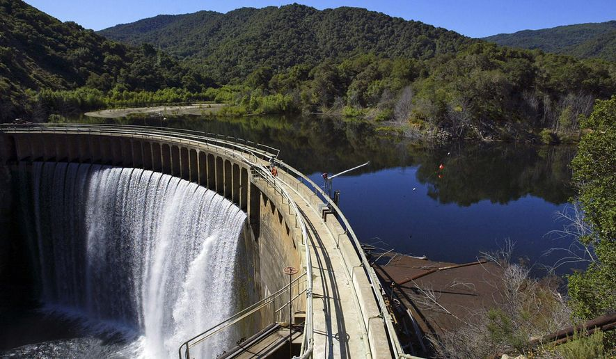 File - In this June 1, 2006 file photo is the San Clemente Dam on the Carmel River in Carmel Valley, Calif.  The largest dam removal project in California history has hit an important milestone with the diversion of a half-mile section of the Carmel River into a man-man river bed. San Clemente Dam has to come down because it was built in 1921 on an earthquake fault and because the reservoir behind it is 95 percent packed with mud. State regulators are worried that if the privately owned dam collapsed homes and businesses downstream would be flooded by muck. (AP Photo/Monterey County Herald, Vern Fisher)