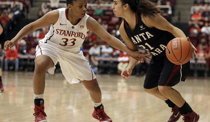 Santa Clara's Raquel Avila, right, drives the ball against Stanford's Amber Orrange (33) during the first half of an NCAA college basketball game Sunday, Dec. 14, 2014, in Stanford, Calif. (AP Photo/Ben Margot)