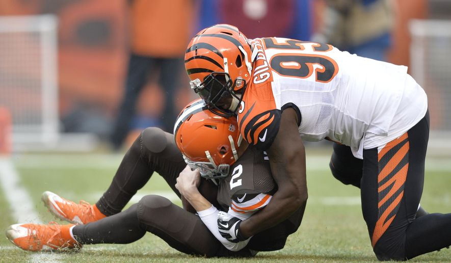 Cincinnati Bengals defensive end Wallace Gilberry (95) sacks Cleveland Browns quarterback Johnny Manziel in the first quarter of an NFL football game Sunday, Dec. 14, 2014, in Cleveland. (AP Photo/David Richard)