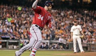 FILE - In this Oct. 7, 2014 file photo, Washington Nationals Bryce Harper celebrates after scoring on a solo home run in the seventh inning against the San Francisco Giants during Game 4 of baseball's NL Division Series in San Francisco. A person familiar with the agreement says Harper and the Washington Nationals have come to terms on a $7.5 million, two-year contract, avoiding a grievance hearing. Harper gets a $2.5 million salary in 2015, and $5 million in 2016. (AP Photo/Marcio Jose Sanchez, File)
