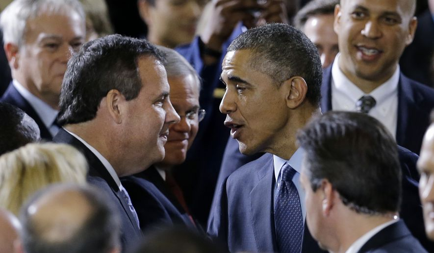 Sen. Robert Menendez, D-N.J., watches at center as President Barack Obama greets New Jersey Gov. Chris Christie after speaking to military members and families Monday, Dec. 15, 2014, at Joint Base McGuire-Dix-Lakehurst, in Wrightstown, N.J. Sen. Cory Booker, D-N.J. is at right. (AP Photo/Mel Evans)