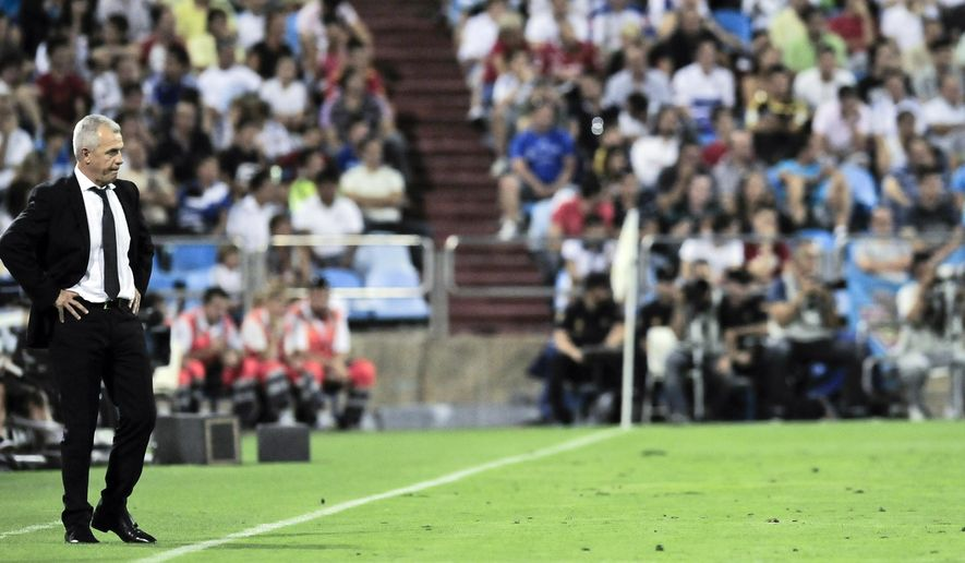 "FILE - In this Aug. 28, 2011 file photo, Zaragoza's Javier Aguirre from Mexico, left, looks on during their Spanish La Liga soccer match against Real Madrid at La Romadera stadium in Zaragoza, Spain. Manchester United midfielder Ander Herrera and Atletico Madrid captain Gabriel ""Gabi"" Fernandez were named Monday, Dec. 15, 2014 as suspects in a match-fixing probe launched by Spain's state prosecutor. They were identified when the prosecutor issued an official complaint and asked the judiciary to investigate officials and players linked to football clubs Zaragoza and Levante in May 2011. The match that was allegedly fixed, in round 30 of the 2010-2011 Spanish league program, was played on May 21, 2011. Five Zaragoza officials, including current Japan coach Aguirre, and 18 players, including Fernandez and Herrera, were named and alleged to have been involved in ""sports fraud. (AP Photo/Alvaro Barrientos, File)"