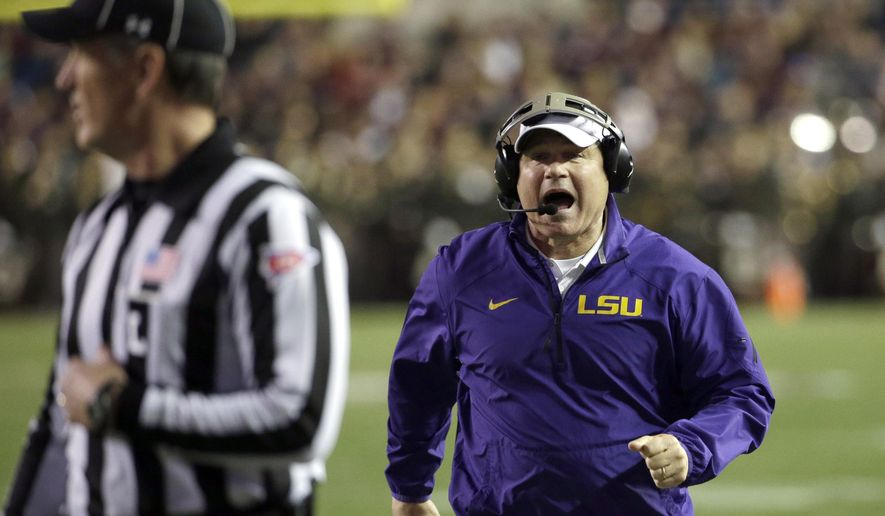 FILE - In this Nov. 27, 2014, file photo, LSU coach Les Miles yells at the officials during the first quarter of an NCAA college football game against Texas A&M, in College Station, Texas. Miles has informed LSU athletic officials that he hasn't been contacted by Michigan about the Wolverines' coaching vacancy and has no intention of leaving the Tigers. LSU spokesman Michael Bonnette says Miles sought to make his status with LSU clear Monday, Dec. 15 following reports by news outlets in Michigan, citing unidentified sources, that Miles had been contacted about the Michigan job. (AP Photo/David J. Phillip, File)