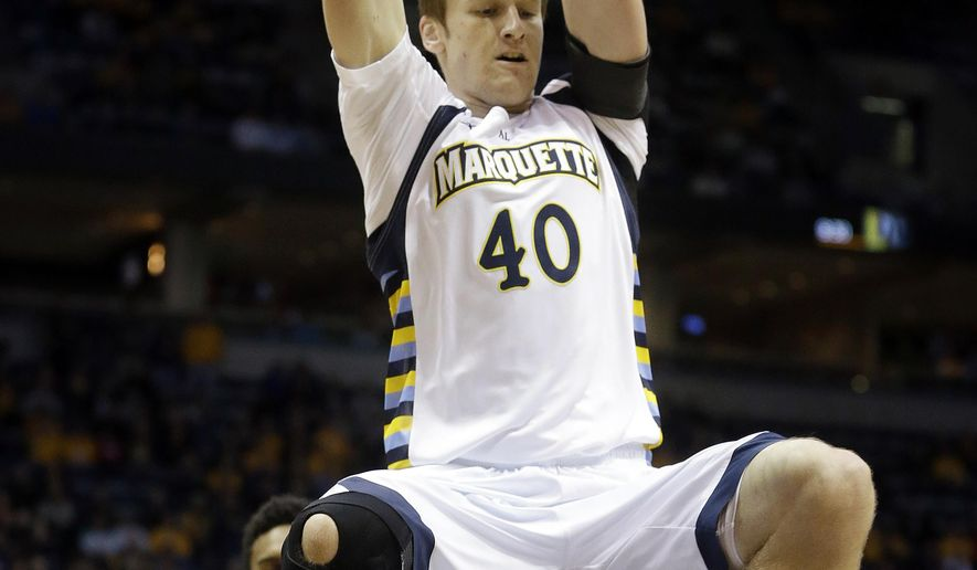 Marquette's Luke Fischer dunks during the first half of an NCAA college basketball game against Arizona State on Tuesday, Dec. 16, 2014, in Milwaukee. (AP Photo/Morry Gash)