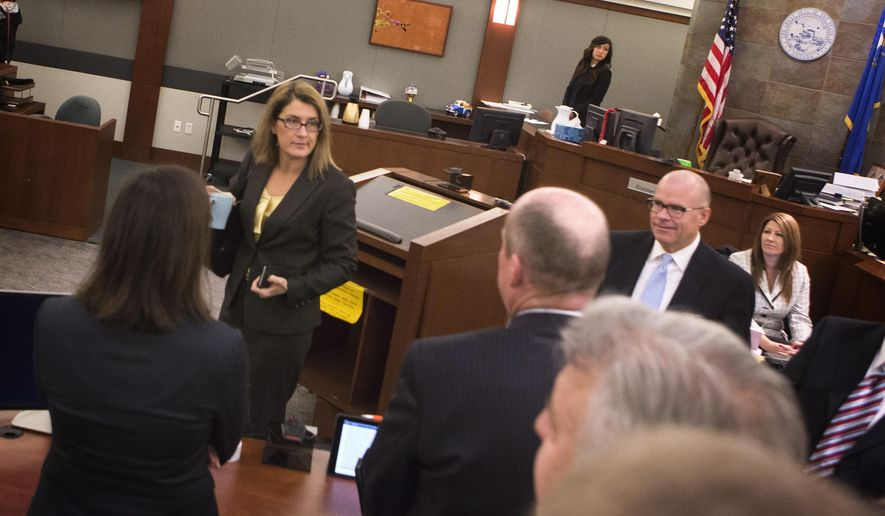 Clark County Chief District Judge Jennifer Togliatti, center talks to counsel at the Regional Justice Center on Tuesday, Dec. 16, 2014 in Las Vegas. A last-minute settlement avoided trial Tuesday in a massive civil breach-of-contract lawsuit involving casino giant MGM Resorts International and six of seven contractors on a never-opened Las Vegas Strip tower called the Harmon.  (AP Photo/Las Vegas Review-Journal, Jeff Scheid) LOCAL TELEVISION OUT; LOCAL INTERNET OUT; LAS VEGAS SUN OUT