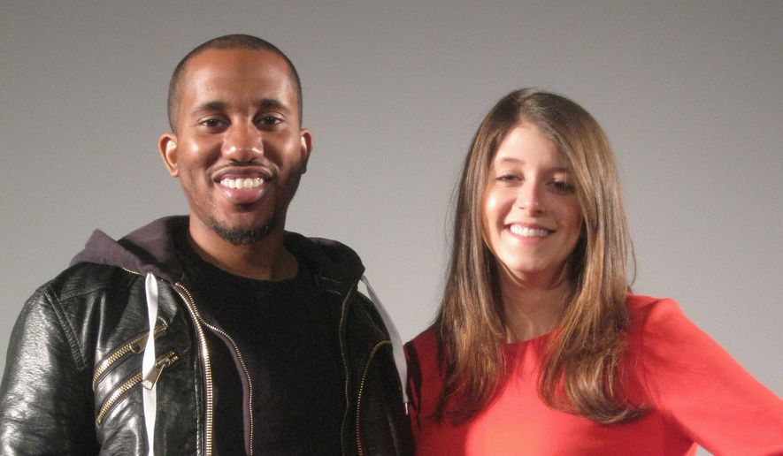 "Chris Redd, with Maria Randazzo of the touring Second City troupe, said, ""We don't hold back any punches. That's what I like. [The audience] can definitely expect the unexpected. It's a fun Christmas show."" (Eric Althoff/The Washington Times)"