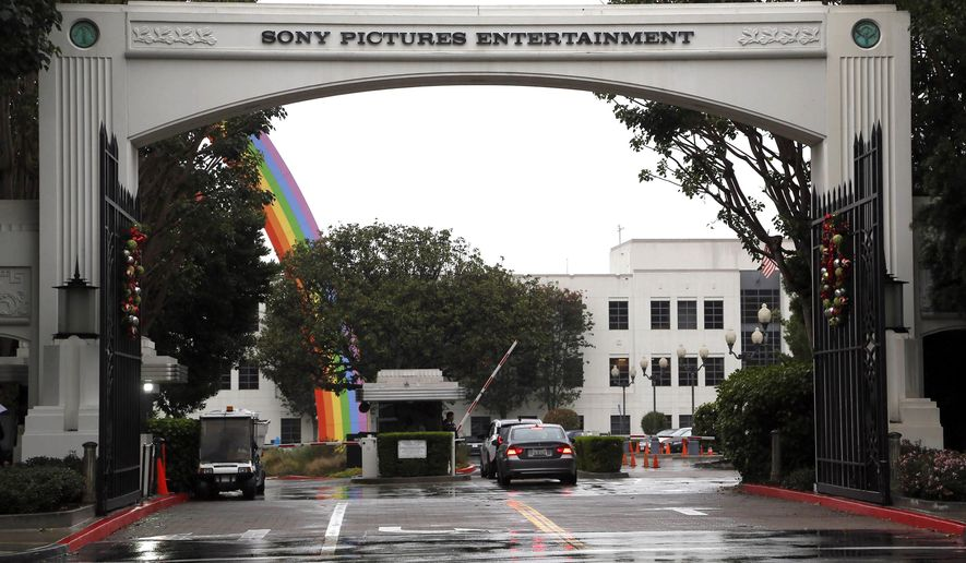 "FILE - In this Dec. 2, 2014 file photo, cars enter Sony Pictures Entertainment headquarters in Culver City, Calif. Hackers calling themselves Guardians of Peace on Tuesday, Dec. 16, 2014 released another round of data leaks, including ominous threats against the premiere of Sony Pictures' film ""The Interview,"" in which the group references the terrorist attacks of September 11, 2001. (AP Photo/Nick Ut, File)"