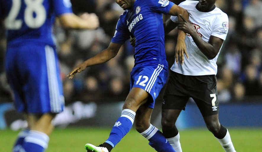 Chelsea's John Obi Mikel is held back by Derby's Simon Dawkins, right, during the quarterfinal of the English League Cup soccer match between Derby County and Chelsea at the iPro Stadium, Derby, England, Tuesday, Dec. 16, 2014. (AP Photo/Rui Vieira)