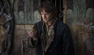 """In this image released by Warner Bros. Pictures, Martin Freeman appears in a scene from """"The Hobbit: The Battle of the Five Armies."""" (AP Photo/Warner Bros. Pictures, Mark Pokorny)"""