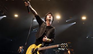 In this Sunday, April 7, 2013, file photo, Billy Joe Armstrong performs during a Green Day concert at the Barclays Center, in New York. (Photo by Jason DeCrow/Invision/AP, File)