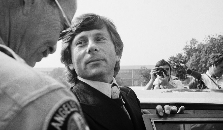 FILE - In this Oct. 25, 1977, file photo, film director Roman Polanski leaves court in Santa Monica, Calif. Attorneys for Polanski are accusing Los Angeles County prosecutors of misconduct, as part of their continued efforts to have decades-old sexual assault charges against the Oscar-winning director dismissed, according to the Los Angeles Times. Polanski fled Los Angeles for France in the 1970s. (AP Photo/Nick Ut, File)