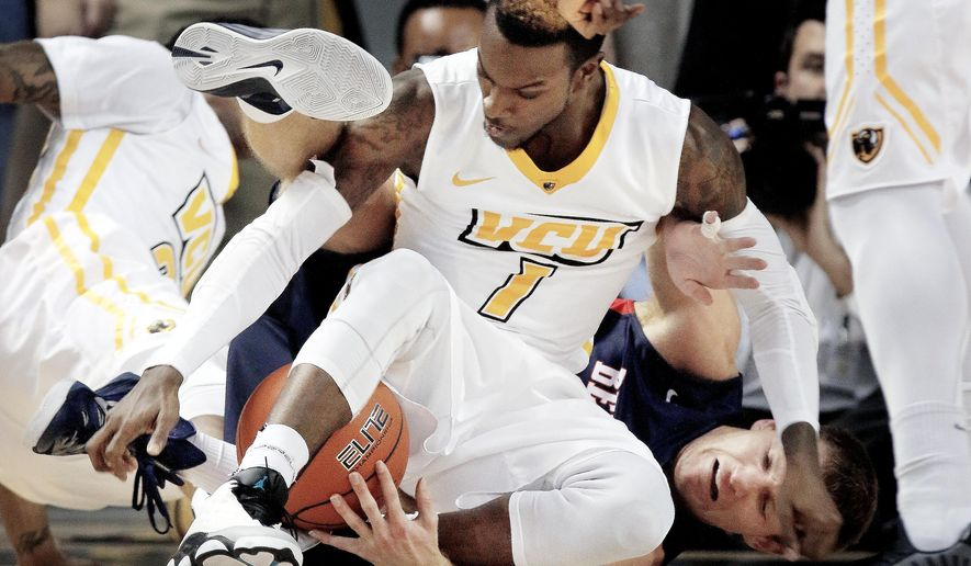 VCU's JeQuan Lewis and Belmont's Reece Chamberlain, right, fight for control of the ball during an NCAA college basketball game Tuesday, Dec. 16, 2014, in Richmond, Va.  (AP Photo/Richmond Times-Dispatch, Alexa Welch Edlund)