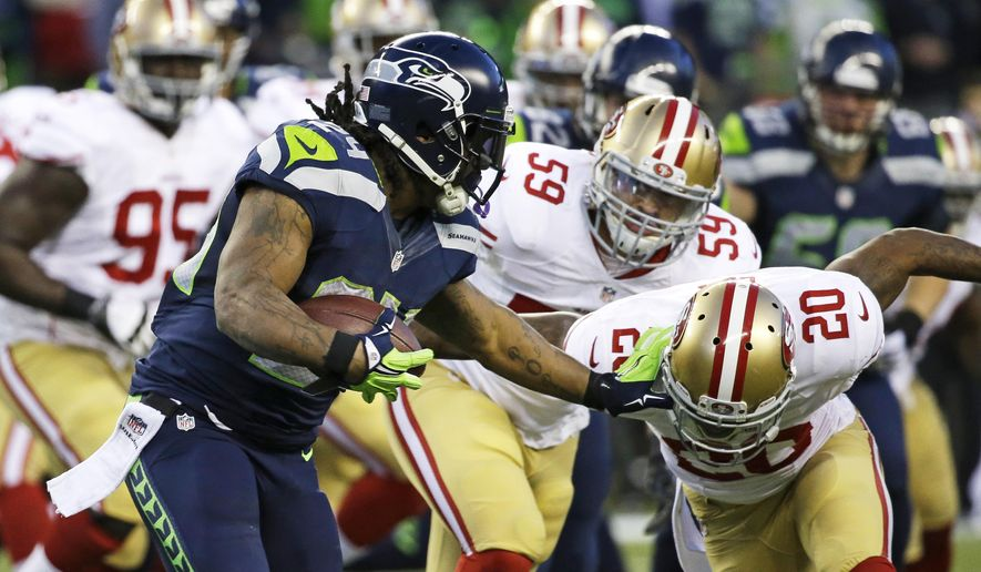 Seattle Seahawks running back Marshawn Lynch (24) pushes off San Francisco 49ers cornerback Perrish Cox, right, in the second half of an NFL football game, Sunday, Dec. 14, 2014, in Seattle. The Seahawks won 17-7. (AP Photo/Elaine Thompson)