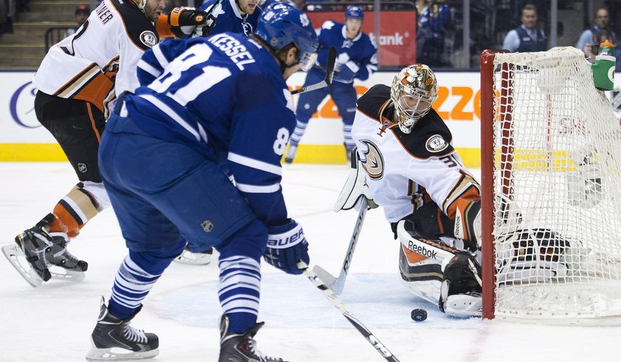 Anaheim Ducks goalie Frederik Anderson (31) makes a save against Toronto Maple Leafs forward Phil Kessel (81) during the second period of an NHL hockey game Tuesday, Dec. 16, 2014, in Toronto. (AP Photo/The Canadian Press, Nathan Denette)