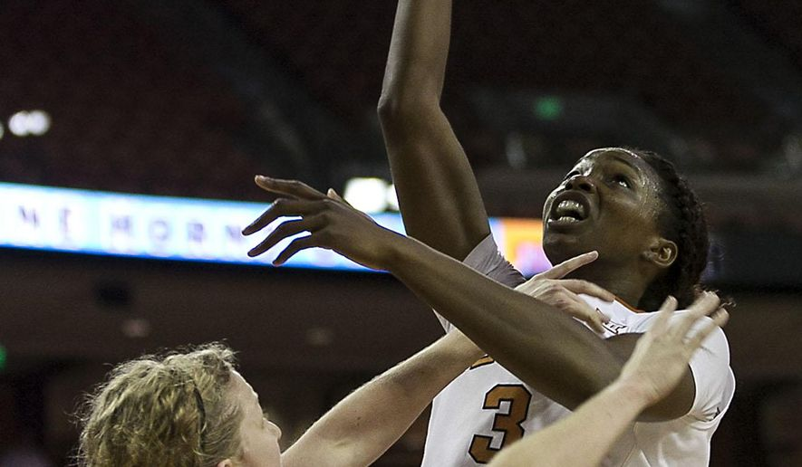 Texas' Nneka Enemkpali (3) shoots over Northwestern State's Presley Owens, left,  during the first half of an NCAA college basketball game, Dec.14, 2014, in Austin, Texas. (AP Photo/Rodolfo Gonzalez)