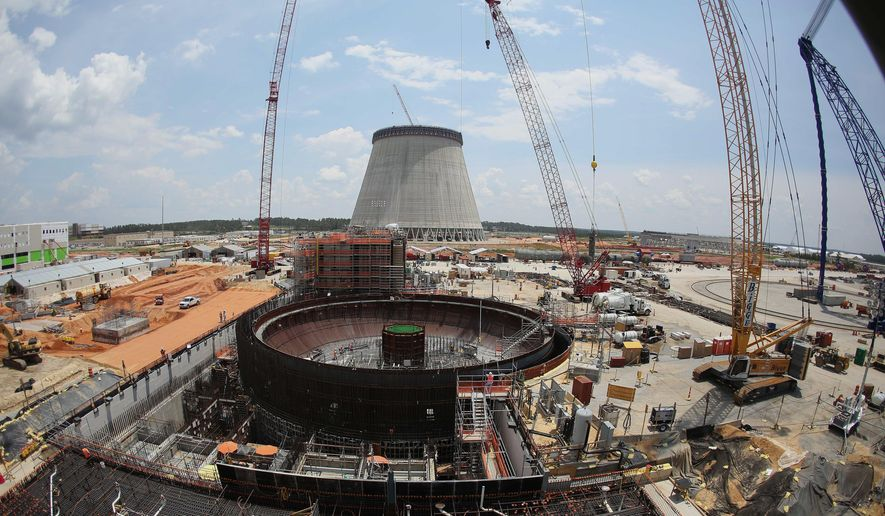 FILE- In this June 13, 2014, file photo, construction continues on a new nuclear reactor at Plant Vogtle power plant in Waynesboro, Ga. An analyst for the Public Service Commission, Steven Roetger, said the timeline for finishing two nuclear reactors at Plant Vogtle is trending almost a year longer than currently scheduled. The first new reactor was supposed to be running by late 2017, followed by the second in late 2018. (AP Photo/John Bazemore, File)