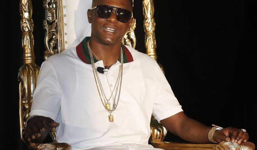 FILE - In this March 10, 2014 file photo, rapper Lil' Boosie, whose real name is Torence Hatch, appears at a news conference in New Orleans. Boosie now goes by the name Boosie Badazz will perform at the Buku Music Festival in New Orleans in March 2015. (AP Photo/Bill Haber, File)