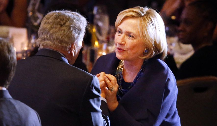 Former Secretary of State Hillary Rodham Clinton speaks to singer Tony Bennett during the Robert F. Kennedy Ripple of Hope Award ceremony, Tuesday, Dec. 16, 2014 in New York. (AP Photo/Jason DeCrow)