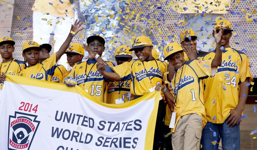 Members of the Jackie Robinson West All Stars Little League baseball team participate in a rally celebrating the team's U.S. Little League Championship in Chicago, in this Aug. 27. 2014, file photo. (AP Photo/Charles Rex Arbogast, File)