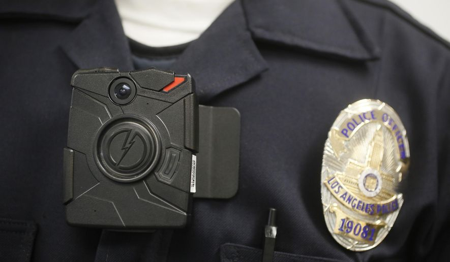 FILE- In this Jan. 15, 2014 file photo a Los Angeles Police officer wears an on-body camera during a demonstration for media in Los Angeles. Mayor Eric Garcetti will unveil a plan Tuesday, Dec. 16, 2014, to equip every officer on the Los Angeles police force with an on-body camera. The department has been field testing body cameras on a small number of its 9,900 officers. Nationally, about one in six officers has been outfitted with a body camera. (AP Photo/Damian Dovarganes,File)