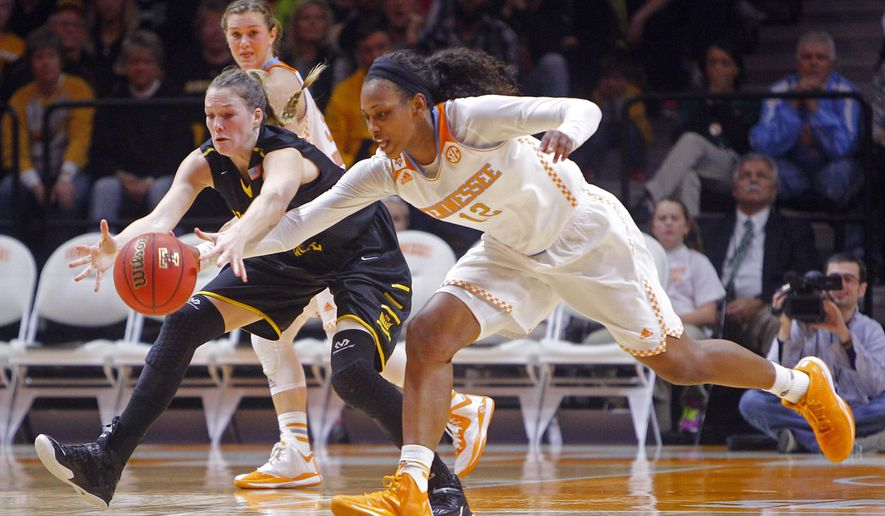 Tennessee forward Bashaara Graves (12) and Wichita State forward Kelsey Jacobs reach for the ball during an NCAA college basketball game Tuesday, Dec. 16, 2014, in Knoxville, Tenn. (AP Photo/Knoxville News Sentinel, Wade Payne)