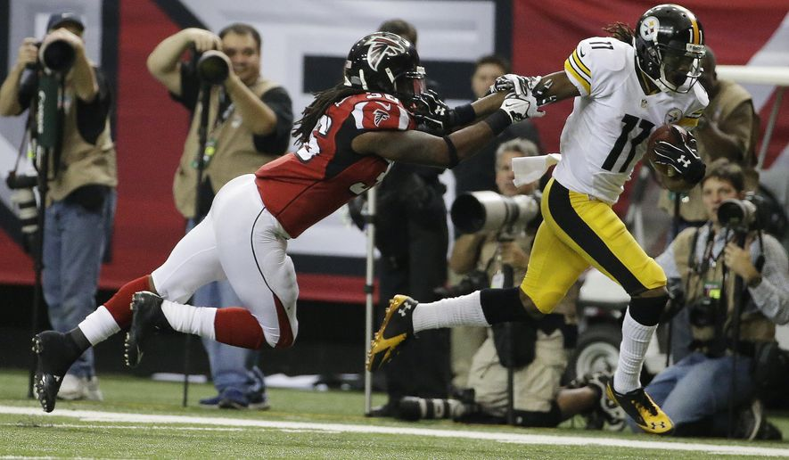Pittsburgh Steelers wide receiver Markus Wheaton (11) runs by Atlanta Falcons cornerback Josh Wilson (26) during the second half of an NFL football game, Sunday, Dec. 14, 2014, in Atlanta. (AP Photo/David Goldman)