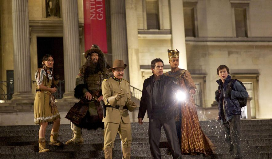 """In this image released by 20th Century Fox shows, from left, Mizuo Peck, Patrick Gallagher, Robin Williams, Ben Stiller, Rami Malek and Skyler  Gisondo in a scene from """"Night at the Museum: Secret of the Tomb."""" (AP Photo/20th Century Fox, Kerry Brown)"""
