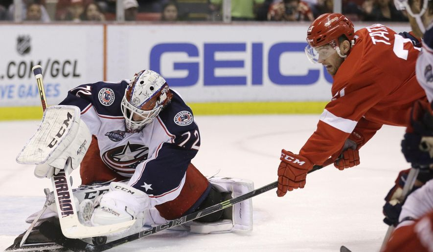 Columbus Blue Jackets goalie Sergei Bobrovsky (72) of Russia stops a shot by Detroit Red Wings left wing Tomas Tatar (21) during the second period of an NHL hockey game in Detroit, Tuesday, Dec. 16, 2014. (AP Photo/Carlos Osorio)
