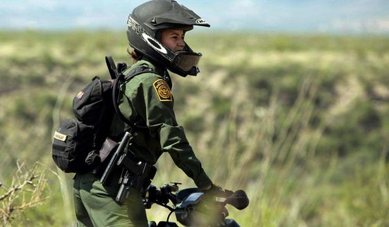 Crystal A. Diaz, a U.S. Border Patrol agent with the Tucson Sector in Arizona, rides her ATV while on patrol.  (AP Photo/U.S. Border Patrol)