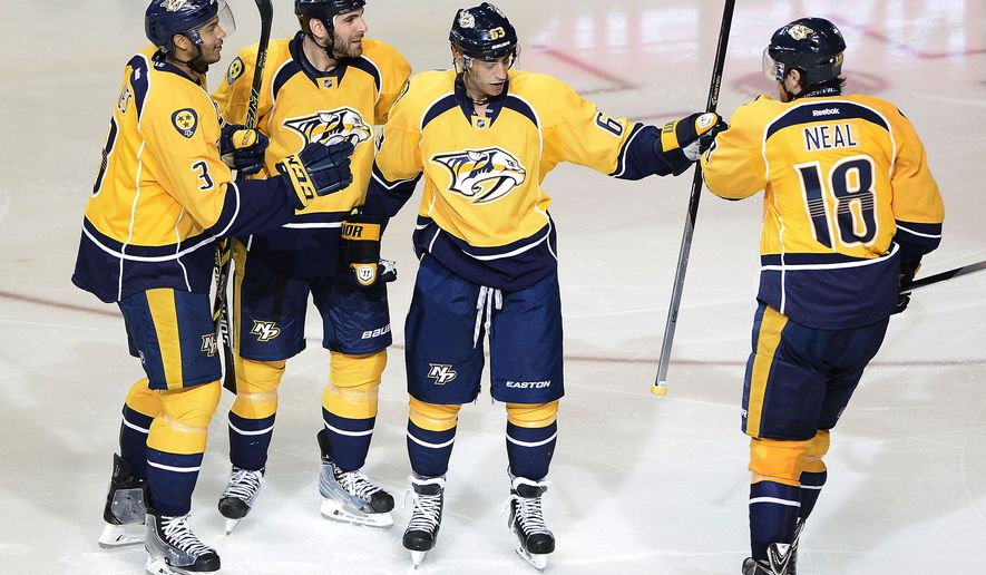Nashville Predators center Mike Ribeiro (63) celebrates after scoring a goal in the third period of an NHL hockey game against the Boston Bruins Tuesday, Dec. 16, 2014, in Nashville, Tenn. (AP Photo/Mark Zaleski)