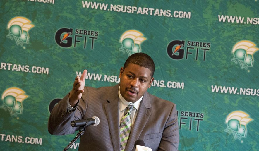 Latrell Scott speaks at a news conference in Norfolk, Va., after being introduced as the new head NCAA college football coach at Norfolk State University, Tuesday, Dec, 16, 2014.  (AP Photo/The Virginian-Pilot, Bill Tiernan)  MAGS OUT