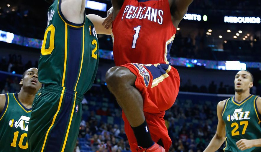 New Orleans Pelicans forward Tyreke Evans (1) drives to the basket against Utah Jazz forward Gordon Hayward, left, during the first half of an NBA basketball game in New Orleans, Tuesday, Dec. 16, 2014. (AP Photo/Jonathan Bachman)
