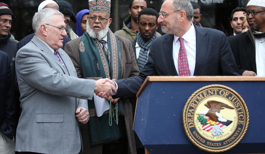 St. Anthony Village Mayor Jerry Faust, left, shakes hands with U.S. Attorney Andy Luger, after Luger announced a settlement resolving a federal lawsuit against the city, on Tuesday, Dec. 20, 2014 in St. Anthony Village, Minn.  The city has agreed to allow an Islamic center in the Minneapolis suburb. Under the settlement, Abu-Huraira Islamic Center will be allowed to worship in the basement of the St. Anthony Business Center. (AP Photo/The Star Tribune, Elizabeth Flores)  MANDATORY CREDIT; ST. PAUL PIONEER PRESS OUT; MAGS OUT; TWIN CITIES LOCAL TELEVISION OUT